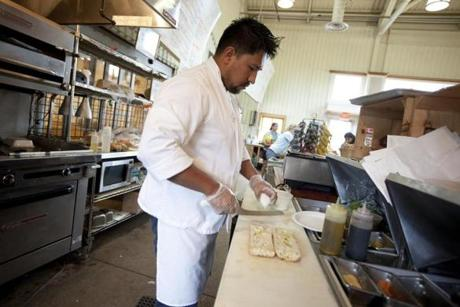 Juan Estevan of Attleboro prepares sandwiches at Ward's Berry Farm.